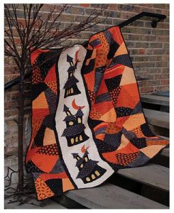 And it has orange and black funky patchwork for your desires. Love the haunted house on this, too.