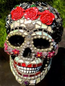 Another mosaic skull with reflective tiles. Yet, this one has flowery, cheeks, lips, and roses.