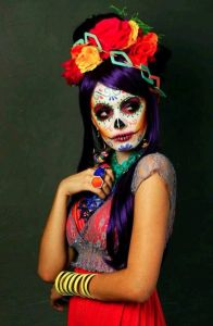 Well, she does have a Joker like face makeup. But you have to love the flowers and the large rings.