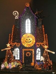 Now this one looks a bit similar to one of the other houses I just showed. Yet, it seems to be a Christmas cottage turned into a Halloween one. Not to mention, it seems more lively.