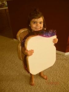 An easy costume with two slices of bread covered in different color plastic wrap. So cute.