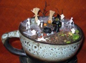 I don't think the teacup is necessarily little. But I love how it's shaded to fit with the Halloween decor on this.