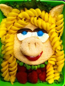 It consists of a sandwich with pasta hair. Also bread ears and snout. But it surely resembles her.
