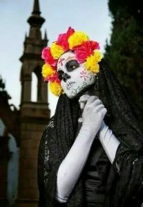 Well, I said they dress up to mock death and the old Mexican elite. Love the flowery black veil.