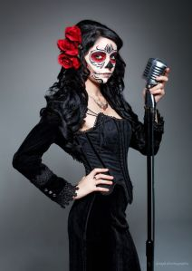This one has a black dress with a rose in her hair. The mic is just a vintage touch akin to Walk the Line.