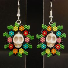 The flowers are beaded. The skulls aren't. But I don't think they go with the pendant I showed earlier.