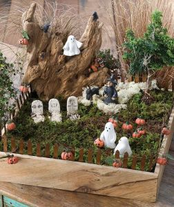 Well, this is a graveyard with a path and an imposing rock. But I'm not sure what the pumpkins are doing here.