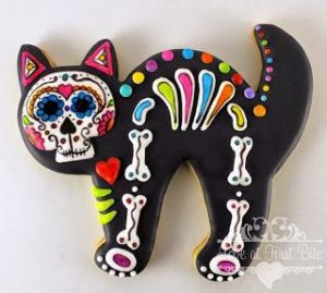 Yes, this is a skeleton cat cookie. And yes, it has a multi-colored rib cage. Don't ask me about it. I wasn't consulted.