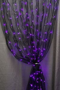 Well, the lights are purple. But ti certainly gives a scary impression. Goes well with the lit spider wreath.