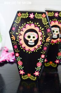 And the one for the Day of the Dead gets a very flowery finish. Love the pink flowery border on this. Stunning.