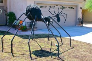 Before setting it up, explain to the neighbors that it's not a real spider and won't hurt anyone. Though they might be scared of it anyway.