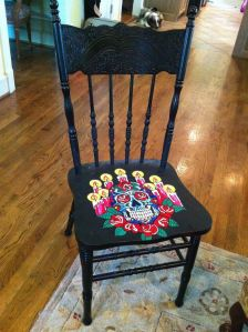 This one has a skull with roses and candles. Yes, it's a morbid but stunning display on the seat.