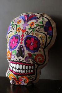 Well, this one is in a skull shape. Contains a purple cross and pink flower eyes.