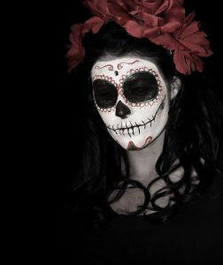 This one has black skull eyes and roses in her hair. But you can see her almost blend into the background.