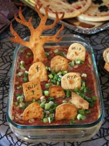 At least I think that's salsa dip. The graves stones and tree are made from crackers. Anyway, it'll be a hit.
