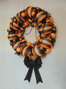 This one has it in stripes and beads. Not sure if black and orange go together like that though.