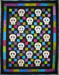 It's as colorful a skull quilt as I've seen one. Each skull is uniquely decorated in its own way.