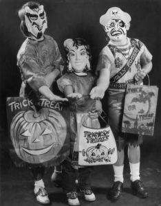 The trick or treat bags are for holding candy. The masks are for scaring the neighbors into giving it to you so they won't have to worry about their lives.