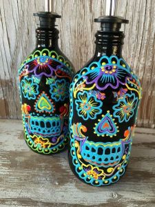 From how I see it, they look like soap dispensers to me. Colorful skulls but soap dispensers nevertheless.
