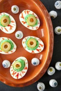 Because on Halloween, deviled eggs should be bloodshot eyeballs. It's only fitting.