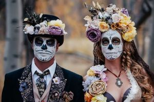 Well, I think this might be from a Dia de los Muertos in California. Yet, both wear the same kinds of flowers and other decoration.