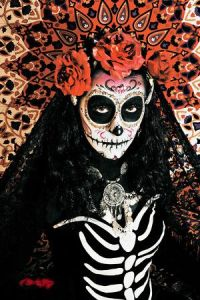 Well, she's dressed in a skeletal outfit. But she has the skull face, flowers, and veil for Dia de los Muertos.