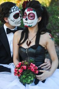 While he has a tux, she has a rose bouquet and a longhorn necklace. Any guess they might be from the Southwest?