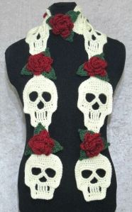 Consists of crocheted skulls and roses. I know they usually don't go together, except at grave sites.