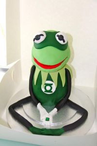This cake has Kermit the Frog as the Green Lantern. Because being green kind of suits him. After all, he's a frog.