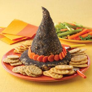 This is decorated with black sprinkles and carrot slices. But it's less disgusting than a skull or eyeball.