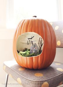 Well, this house is a paper cut out. Yet, I do love how they used moss and trees for the scary decor.