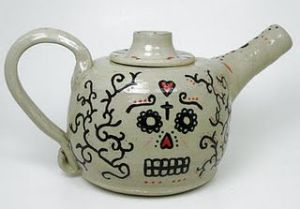 Yes, this is a pottery tea pot or kettle. And it has a skull design to fit with the occasion.