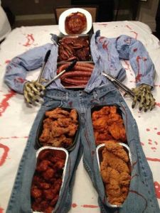 Like how the zombie has tongs in both hands. By the way, ribs and sausage are in the torso. Chicken is in the legs.