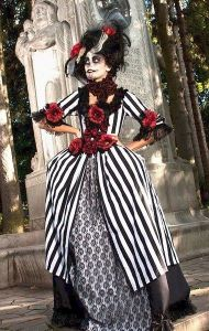 Reminds me of a Dia de los Muertos character Tim Burton would create. This especially since I think Helen Bonham Carter wore a similar outfit in Sweeny Todd.