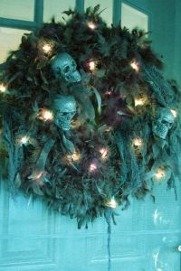 And yes, that does seem like a wreath you'd see on a haunted house. It looks quite tattered with skulls on it. Love it.