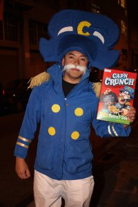 One of the most famous cereal mascots of our times. He even has Captain Crunch cereal to show.