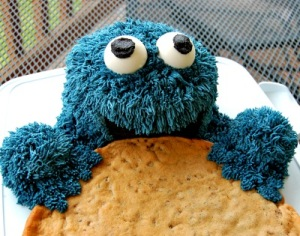Don't worry, this is part of the cake. However, if it was real, Cookie Monster would probably reduce it to crumbs.