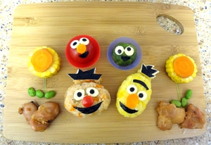 Seems of the bento box variety. Yet, though Ernie is made from rice, Bert is made from corn. Like the flowers, too.