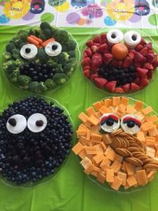 There's broccoli Oscar, strawberry Elmo, blueberry Cookie Monster, and cheddar cheese Big Bird. Like how Big Bird's nose is made from Ritz crackers.
