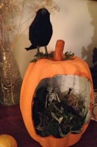 Now that looks pretty creepy, especially with the foliage. Love the crow on top. Or is that a raven?