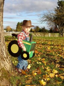You see how the kid is dressed as a farmer in coveralls. Adorable.