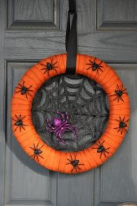 Another wreath to freak out arachnaphobes. Too bad the purple spider hogs the web from the black ones.