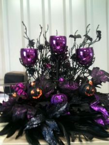 Yes, it's another Halloween candle display. But this has feathers and pumpkins. Love the purple holders.