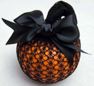 Might want to go with a craft pumpkin if you want it to last. But I really like the black ribbon and lace on this.