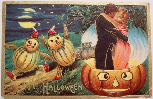 Not sure what's freakier in this picture. Is it the couple making out while the jack-o-lantern doesn't seem to mind? Or the gourd people watching it?
