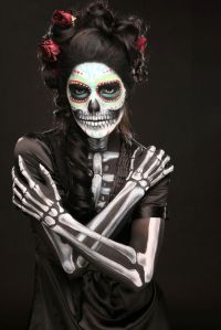 Well, she has a lot of skeleton makeup on her. Yet she has a black dress on to, if you look closer.