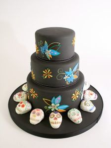 Like you see on this cake, which wouldn't be for Dia de los Muertos without them. Still, love the flowers.