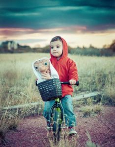 He's the boy from E. T. who befriends the titular alien. And here they are on his bike.