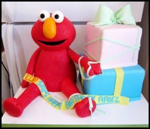 Even has Elmo near the presents. Certainly a birthday cake for a little kid. So cute.