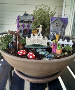 This seems to have a little Halloween village going on. There's even a witch and a Grim Reaper there, too.